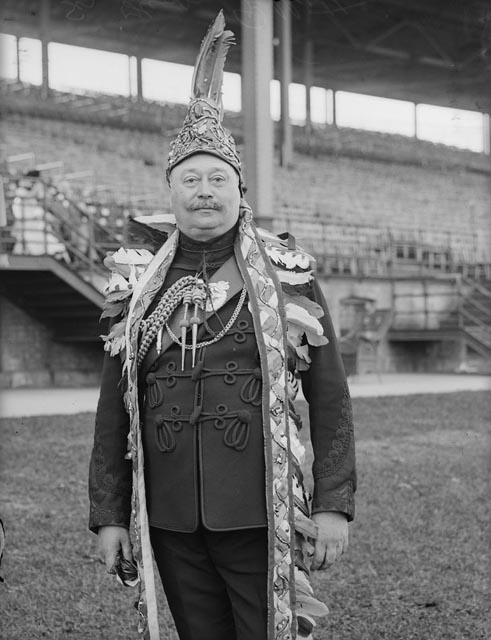 Sir Henry Pellatt in Queen's Own Rifles uniform and Mohawk clothing, CNE Grandstand. - June, 1910